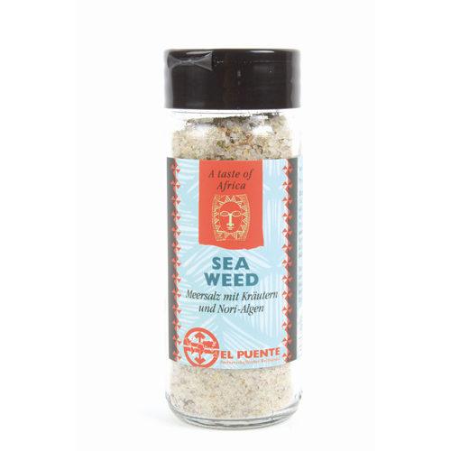 Bote de cristal de sal con algas